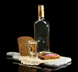 Bottle of vodka, sandwich with salted fish and glasses