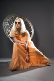 Soft focus retro hippie 70s fashion sensual girl with long blond
