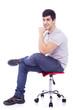 Handsome latin man sitting on a chair, isolated over a white bac