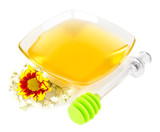 Sweet honey in glass bowl isolated on white