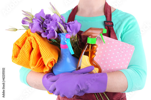 Housewife holding cleaning equipment in her hands. Conceptual