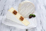 Tasty Italian cheese on wooden table