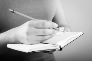 Woman Writing In Notebook Black and White