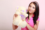 Childish woman infantile girl hugging teddy bear toy