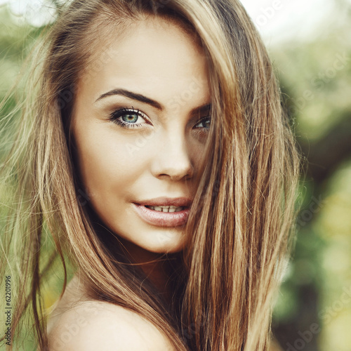 Beautiful young woman face closeup - perfect skin