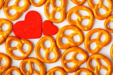 Valentine's day background pretzels pattern and red heart.