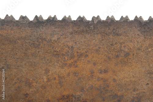 Teeth of old handsaw on white background