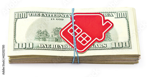 red home sign on hundred dollar bills. Real Estate business Conc