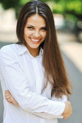 Beautiful cheerful teen girl in white shirt - outdoor