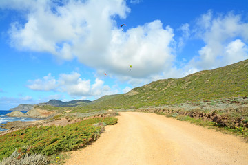 dirt road and para gliders