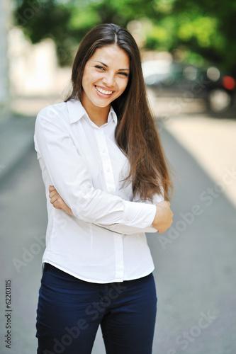 Beautiful cheerful teen girl in white shirt - outdoor - 62203115