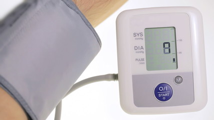 Checking measuring blood pressure with electronic device tool.