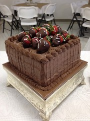 chocolate cake with chocolate covered strawberries