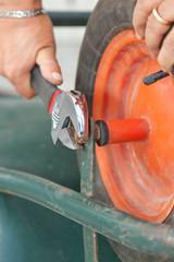 Replacing the tire of a wheelbarrow.