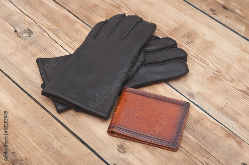 black man's leather gloves with wallet
