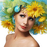 Spring Woman. Beautiful Girl with Easter Eggs and Yellow Daisy