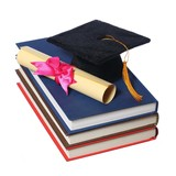 Black Graduation Cap with Degree on Books isolated on White