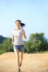 fitness woman running on desert trail