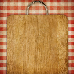 hardboard or breadboard over red gingham picnic tablecloth