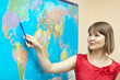 Woman showing something on world map