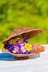 bouquet of bright wildflowers in wicker shell