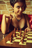 Sexy girl playing chess
