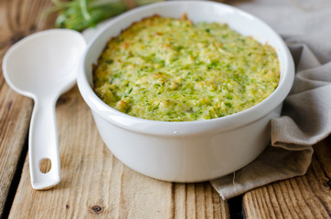 Casserole with cheese and wild garlic