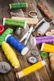 Scattered sewing spools and buttons