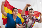 Men watching football match on TV and cheering of spanish team