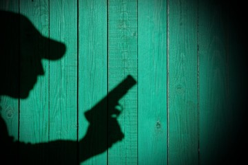 Shadow of a man with a gun, XXXL image