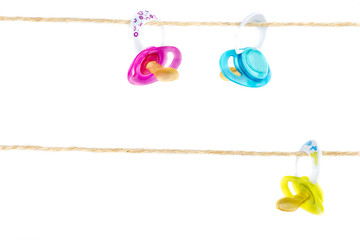Pacifiers hanging