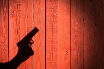 Hand with a gun on a wooden fence, XXXL image
