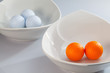 White ceramics bowls and golf balls