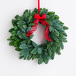 Advent wreath over a bright wall - 62212348