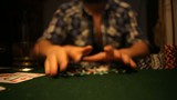 Poker players wins and takes the money