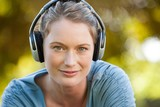 Close-up of beautiful woman enjoying music in park