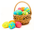 Colorful easter eggs in the basket isolated on a white - 62212975