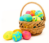 Fototapety Colorful easter eggs in the basket isolated on a white