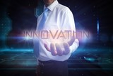Businessman presenting the word innovation