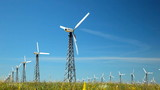 Wind turbines over blues sky background