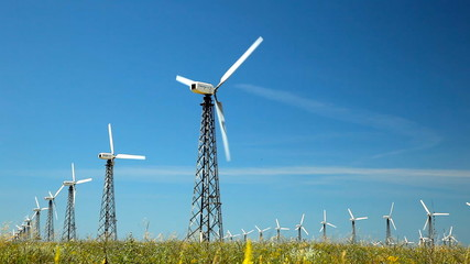 Wind turbines over blues sky background