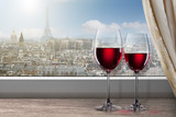 View of Paris and Eiffel tower from window with two glasses of w
