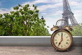 View of Paris and Eiffel tower from window with alarm clock