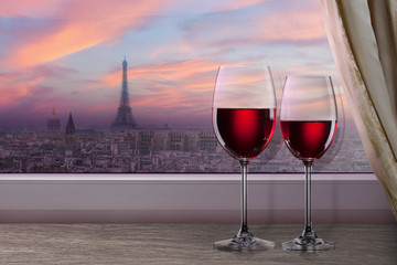 View of Paris and Eiffel tower on sunset from window with two gl