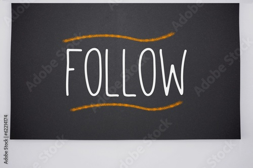 Follow written on big blackboard