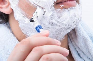 man shaves