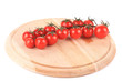 Cluster of Tomatoes on wooden platter.