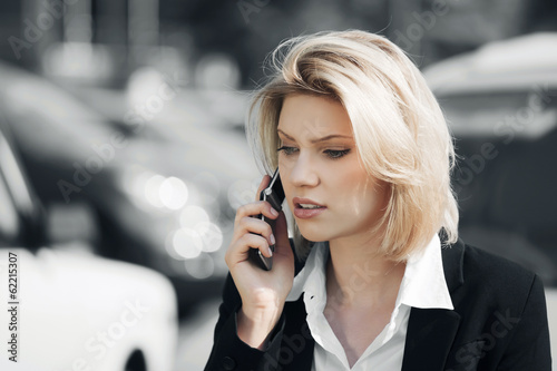 Business woman calling on the cell phone outdoor