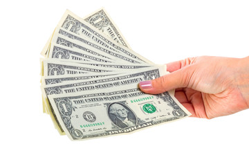 Dollar banknotes in female hand isolated over white
