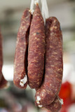 Home made meat salami sausage at street market hanging